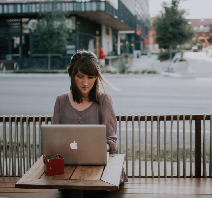 Picture of woman typing on laptop