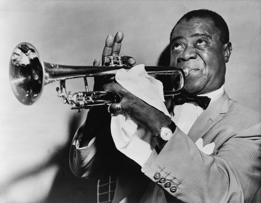 Louis Armstrong playing the trumpet.